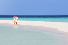 Romantic Couple Walking On Beautiful Tropical Beach Royalty Free Stock Photography