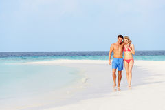 Romantic Couple Walking On Beautiful Tropical Beach. Smiling Stock Photography