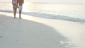 Romantic Couple Walking On Beautiful Tropical Beach stock video footage