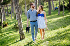Romantic couple walking forest. Barefoot Royalty Free Stock Photography