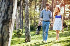 Romantic couple walking forest royalty free stock photography