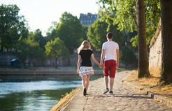 Romantic couple walking near the Seine Royalty Free Stock Photography