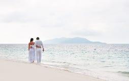 Romantic Couple Walking On The Sea Shore Stock Photos