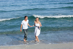 Romantic couple walking at the seaside Stock Photo
