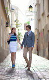 Romantic couple walking on a street of Montmartre Stock Photography