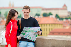 Romantic couple walking together in Europe. Happy lovers enjoying cityscape with famous landmarks. Stylish urban young. Happy tourist couple, men and women royalty free stock images
