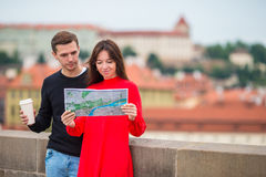 Romantic couple walking together in Europe. Happy lovers enjoying cityscape with famous landmarks. Happy tourist couple, men and women traveling on holidays in stock photos