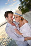 Romantic couple walking on the tropical beach in sunset Royalty Free Stock Photos