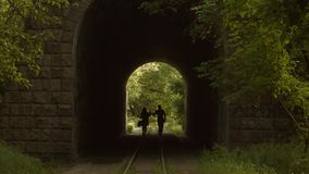 Romantic Couple Walking Through a Tunnel stock video