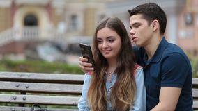 Romantic couple watching video on smartphone stock video footage