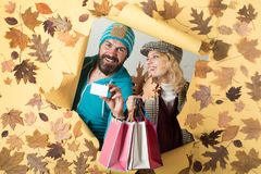 Romantic couple wearing pullover on autumn leaves background. Happy family in Autumn. Black friday sale. Time for. Fashion sale royalty free stock photography