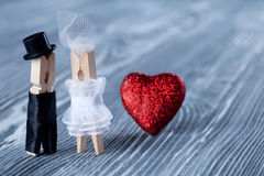 Romantic couple. Wedding invitation. Valentines day. Man, woman and read heart. Groom in black suit and bride in white dress. Stock Image