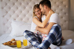 Romantic couple on weekend. Romantic loving couple in morning in bed Stock Photography
