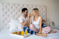 Romantic couple on weekend. Romantic loving couple in morning in bed Royalty Free Stock Images
