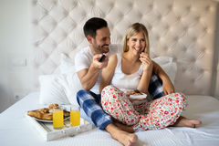 Romantic couple on weekend. Romantic loving couple in morning in bed Stock Image