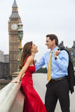 Romantic Couple on Westminster Bridge by Big Ben, London, Englan. Romantic men and women couple on Westminster Bridge with Big Ben in the background, London Stock Images