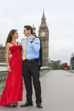 Romantic Couple on Westminster Bridge by Big Ben, London, Englan. Romantic men and women couple on Westminster Bridge with Big Ben in the background, London Royalty Free Stock Images