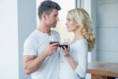 Romantic Couple in White Having Glass of Wine Royalty Free Stock Photography
