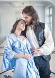 Romantic couple woman and man in medieval clothes. Beautiful romantic couple women and men in medieval clothes Stock Photo