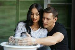Romantic couple working on potter wheel Stock Photography