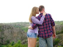Romantic couple of young tourists on a natural background. Love concept. Copy space. stock photography