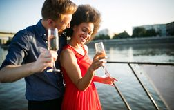 Romantic happy couples dancing and drinking at party stock images