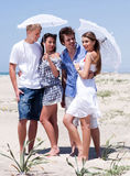 Romantic couples of four at the beach Royalty Free Stock Image