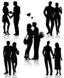 Romantic couples silhouettes Stock Photos