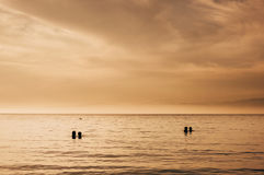 Romantic couples watching sea sunset Royalty Free Stock Photography
