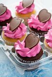 Romantic cupcakes with pink frosting Royalty Free Stock Photo