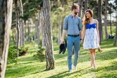 Romantic couple walking forest. Romantic cute young couple walking forest barefoot Stock Images