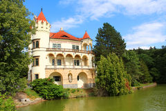 Romantic Czech castle reflected in the water Royalty Free Stock Image