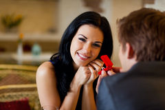 Romantic date. Marriage proposal, men give ring to his girl, young happy couple romantic date at restaurant, celebrating valentine day Stock Photography
