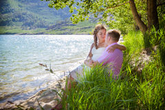 Romantic date. On the bank of the lake Stock Photos