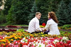 Romantic date in the flower park Stock Photography