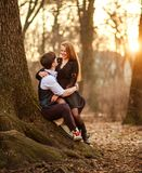 Romantic date of loving young couple in classic dress in fairytale forest park. Tic date of a loving young couple in classic dress in a fairytale forest park on stock photography