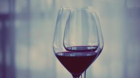 Romantic date night and drink for two, glasses of red wine indoors at wine-tasting event, holiday drink and aperitif as