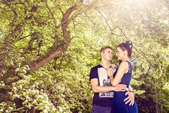 Romantic date in park in sunny day Royalty Free Stock Photos