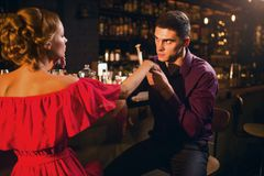 Romantic date in restaurant, woman flirts with man Royalty Free Stock Images