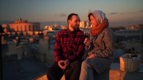 Romantic date on the roof. Loving couple dating on the roof at the sunset. Drink wine. Saint Petersburg stock video