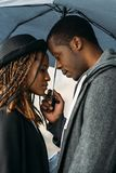 Romantic date. Tender black couple. African American cute relationship, beautiful young people on rainy day, stylish concept Stock Photos