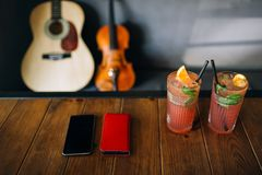 Romantic date music player drinks. Romantic date of two music lovers. spend some quality time at a bar with refreshing beverages. modern phone technology concept Royalty Free Stock Photo