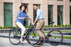 Romantic date of young couple on bicycles Stock Photography