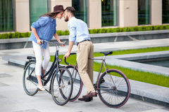 Romantic date of young couple on bicycles Stock Photos