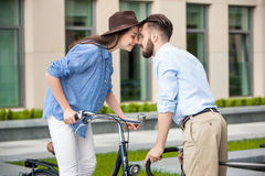 Romantic date of young couple on bicycles Royalty Free Stock Image