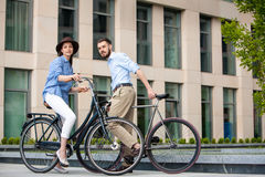 Romantic date of young couple on bicycles Stock Photo