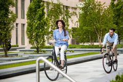 Romantic date of young couple on bicycles Stock Image