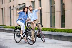 Romantic date of young couple on bicycles Royalty Free Stock Photo