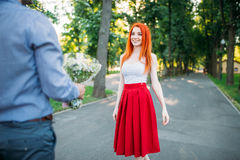 Romantic date, young couple meeting in summer park Royalty Free Stock Image
