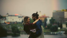 Romantic date of young happy couple in downtown on sunset. Hipster man and woman hugging, having fun in the evening. Hipster male and female enjoying the city stock video footage
